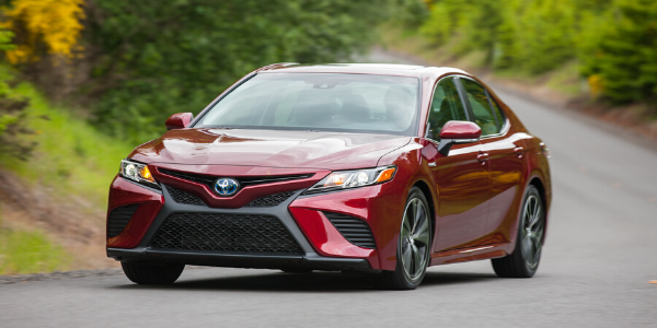 Front view of red 2020 Toyota Camry SE Hybrid on the road