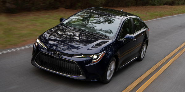 Front view of 2020 Toyota Corolla XLE Blue Print on the road