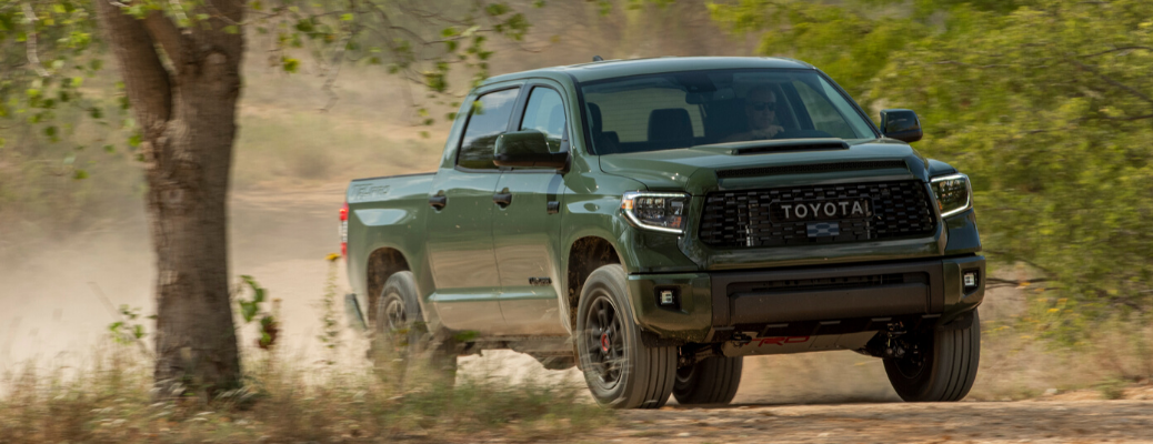 Army Green 2020 Toyota Tundra going off-road