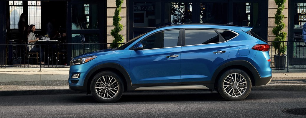 The side image of a blue 2020 Hyundai Tucson.
