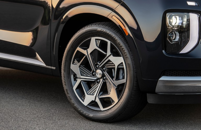 The front tire and rim of a 2021 Hyundai Palisade Calligraphy.