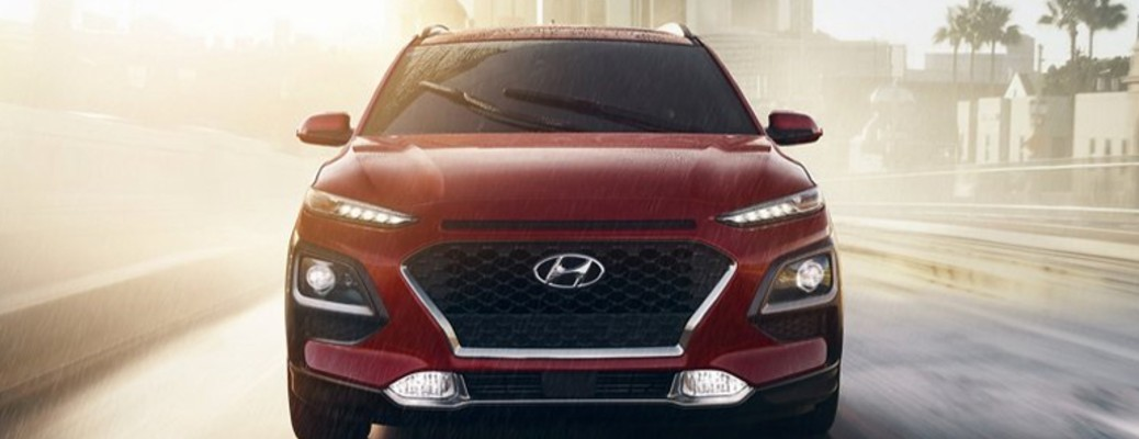 The front end of a red 2021 Hyundai Kona.