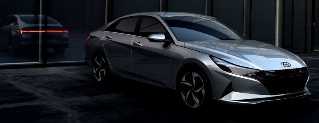 The front and side view of a gray 2021 Hyundai Elantra.