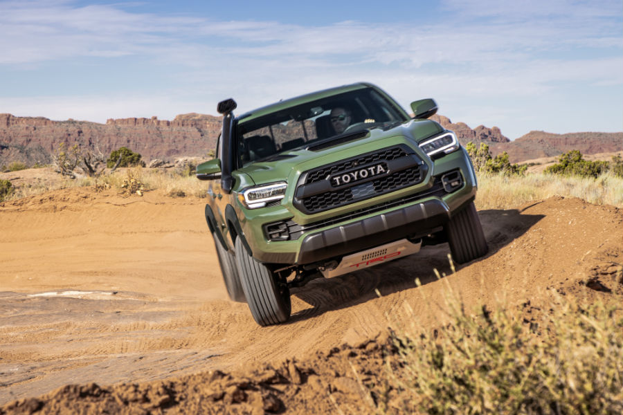 A head-on photo of the 2020 Toyota Tacoma parked on a banked turn.