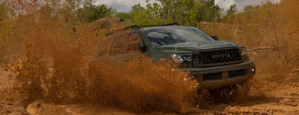 A photo of the 2020 Toyota Sequoia TRD going through the mud.