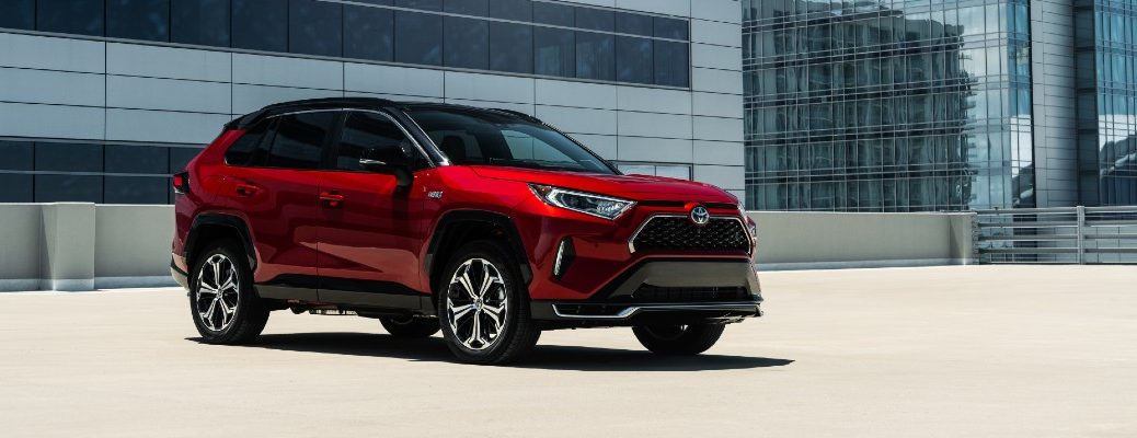 A photo of the 2021 Toyota RAV4 Prime on a roof-top parking lot.