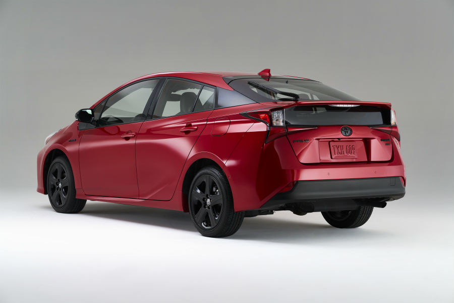 A rear left quarter photo of the 2021 Toyota Prius.
