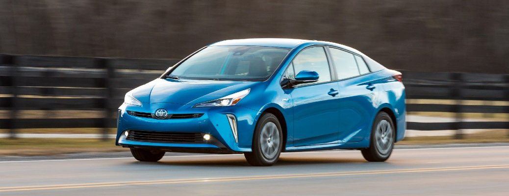A photo of the Toyota Prius in motion on the road.