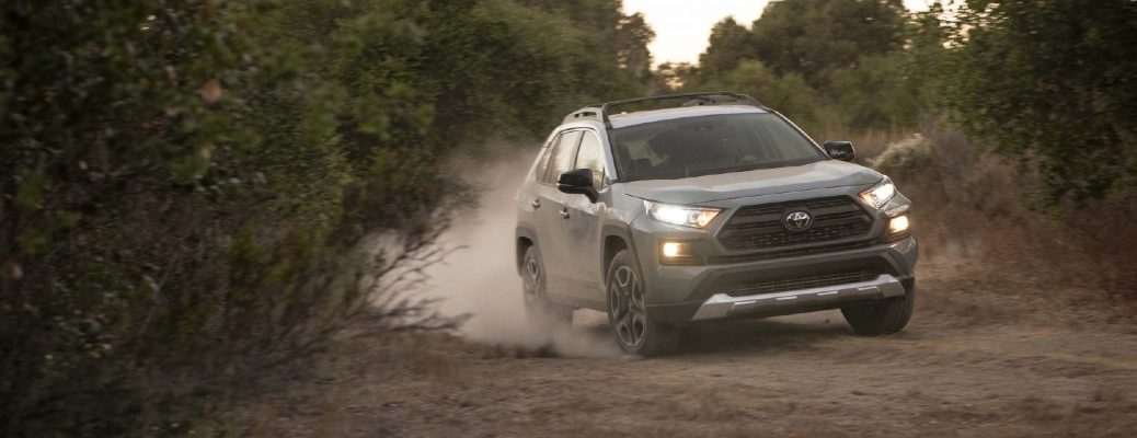 A photo of a 2021 Toyota RAV4 coming down a gravel road.