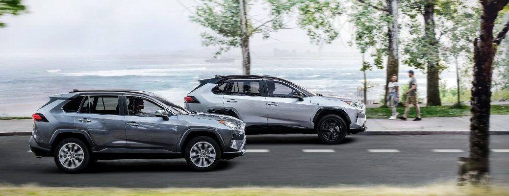 A photo of two 2021 Toyota RAV4 models on the road.
