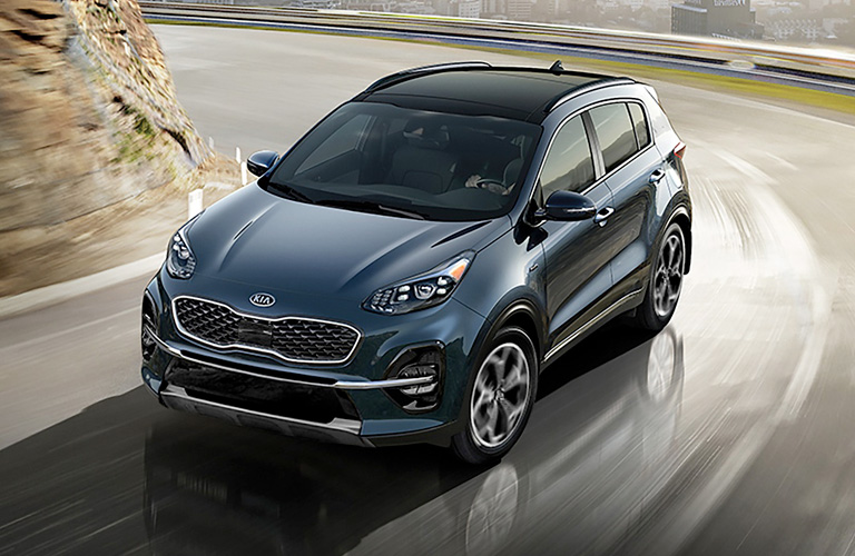 Exerior view of a blue 2020 Kia Sportage