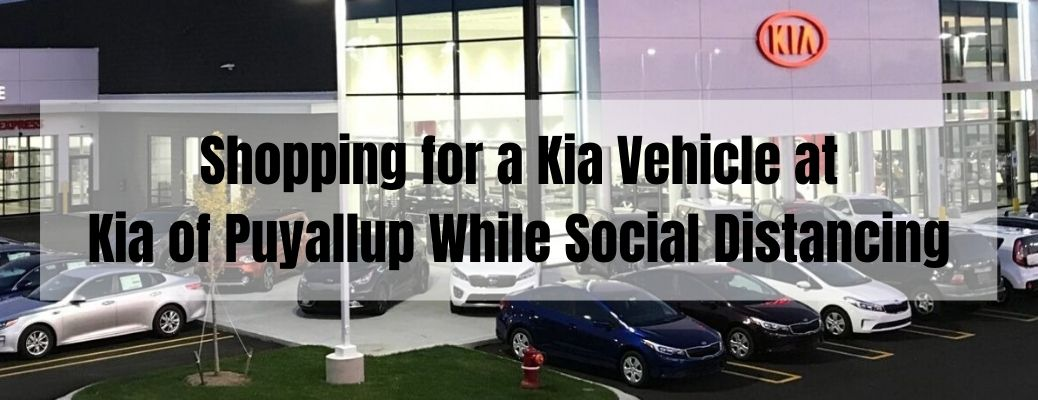 Shopping for a Kia Vehicle at Kia of Puyallup While Social Distancing banner with a Kia dealership in the background