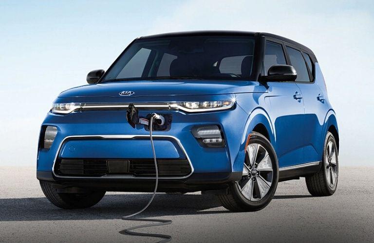 Exterior view of the front of a charging blue 2021 Kia Soul EV