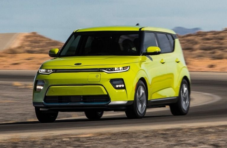 Exterior view of the front of a bright yellow 2021 Kia Soul EV