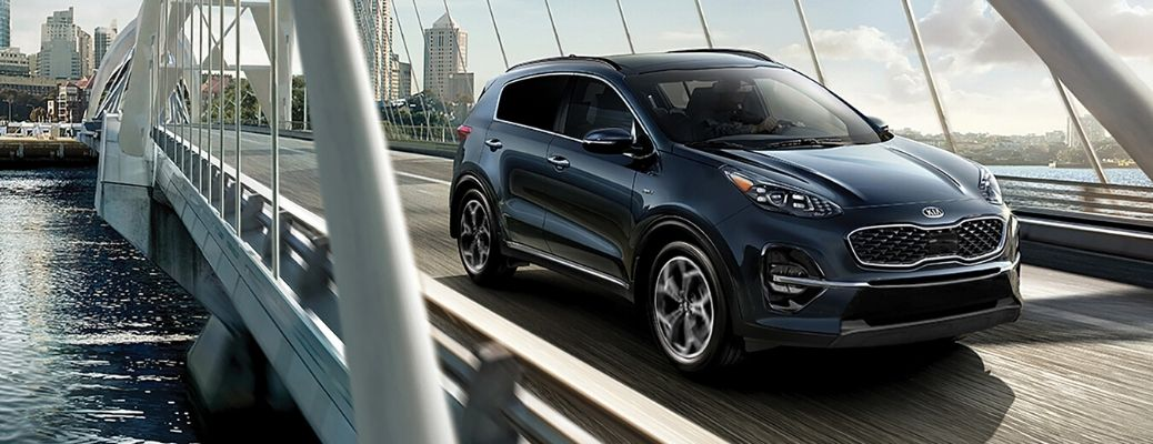 Exterior view of a Pacific Blue 2020 Kia Sportage
