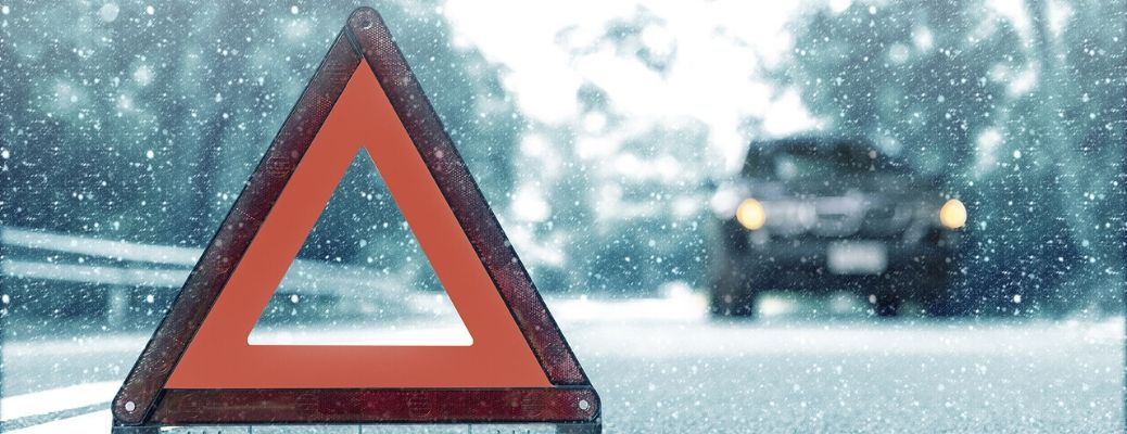 Image of a triangle reflector on a snow-covered road