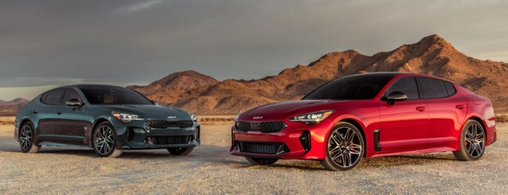 Black and Red 2022 Kia Stinger Cars in a hilly background