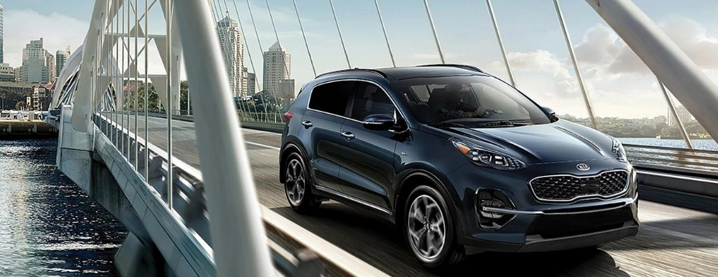 Blue 2022 Kia Sportage on a bridge. Learn about the safety features