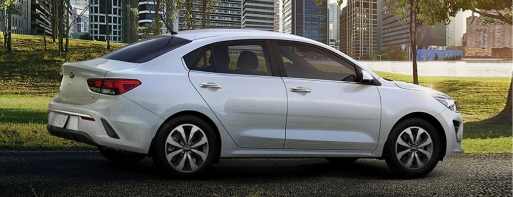 White 2021 Kia Rio on a parking spot. What are the engine specifications?