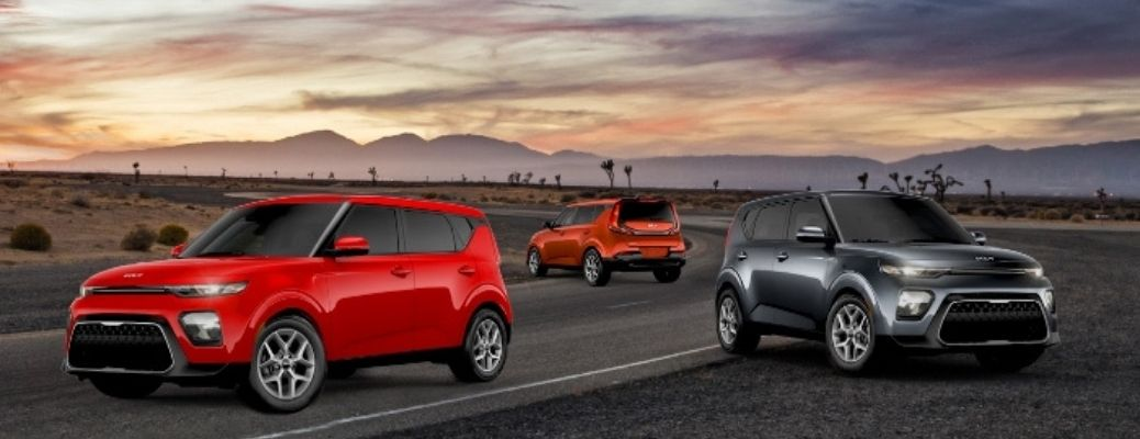 The 2022 Kia Soul on the highway during sunset.