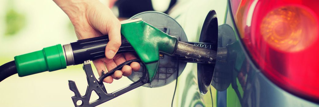 person filling up vehicle with gas