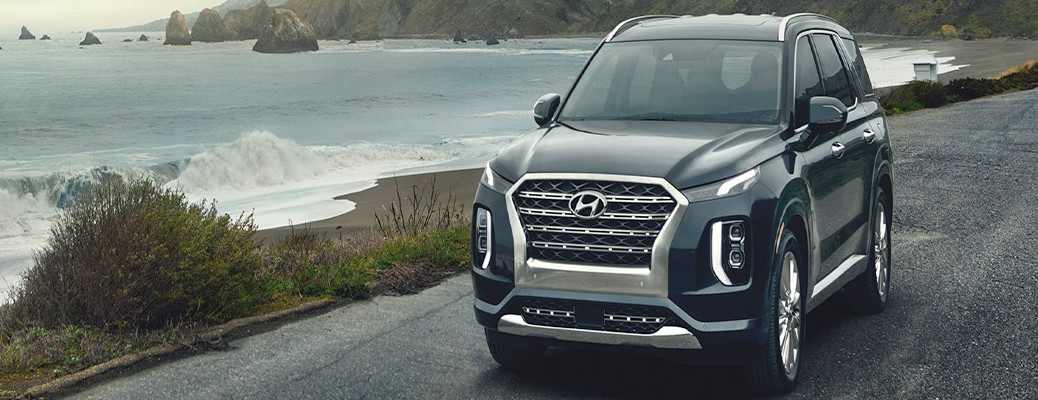 2020 Hyundai Palisade exterior front fascia driver side on highway with ocean
