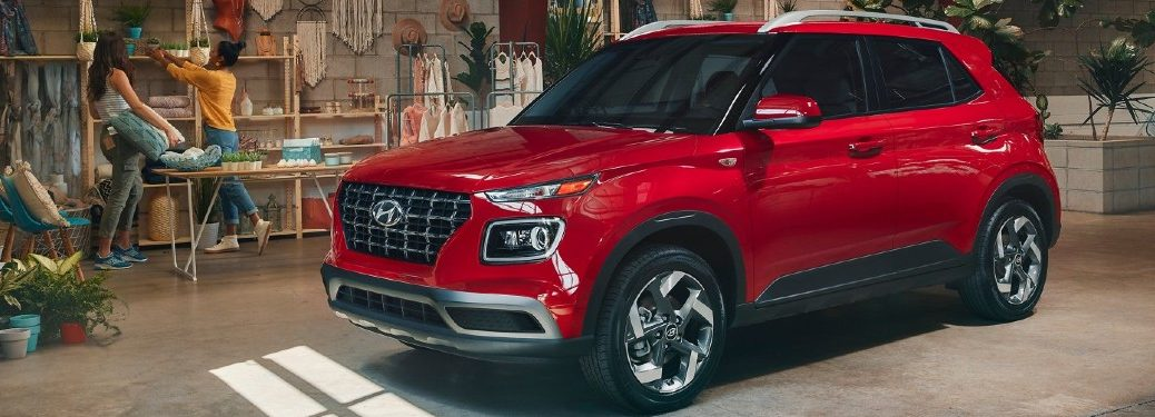 2021 Hyundai Venue red exterior front fascia driver side parked in store