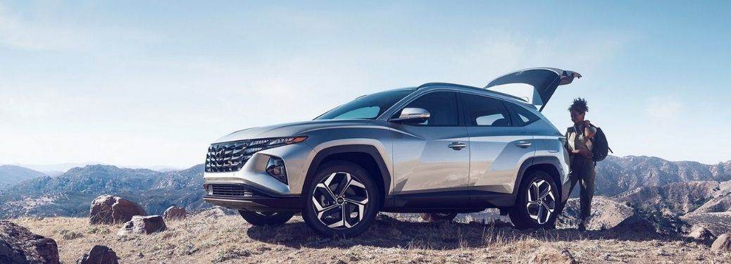 2022 Hyundai Tucson Left-Side View Parked with rocky hills in the background.
