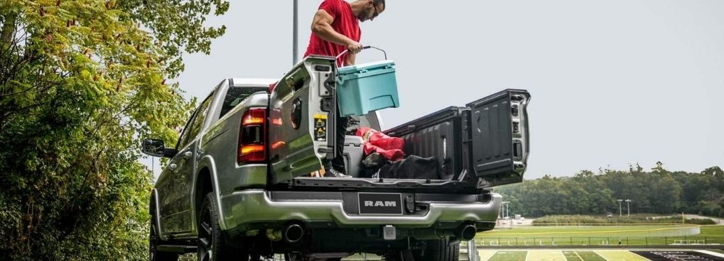 Man Loading Cargo in the Bed of a 2021 Ram 1500