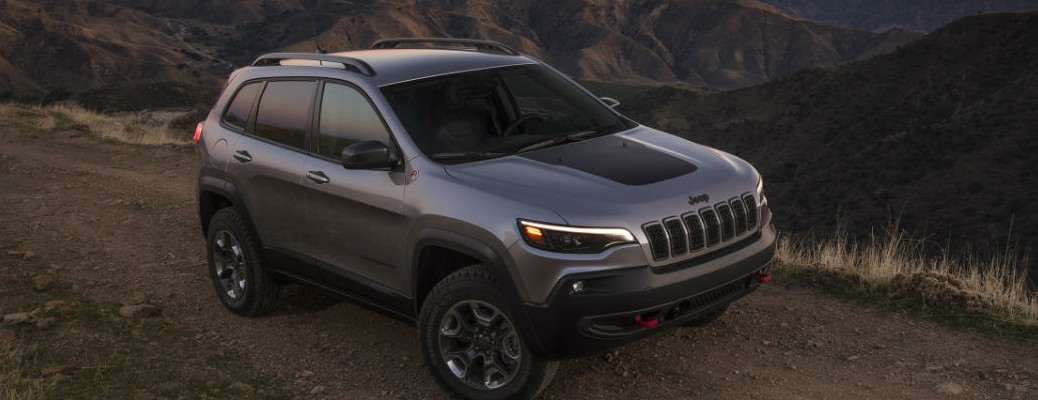 2021 Jeep Cherokee driving on gravel road