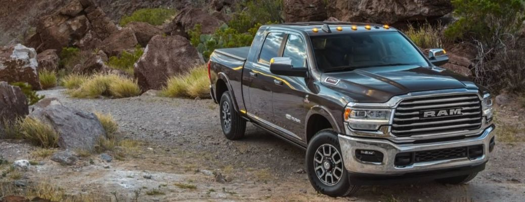 Metallic Gray 2021 Ram 2500 on a off-roading terrain. What are the engine specifications?
