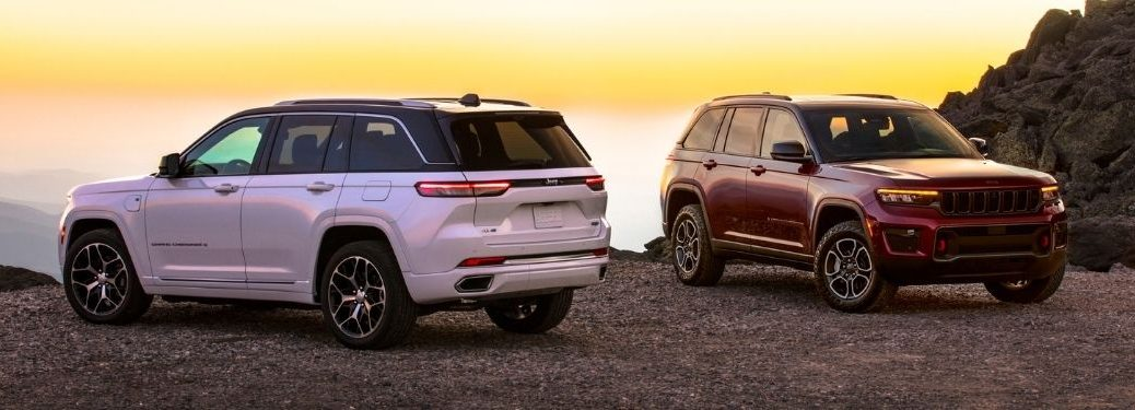 White and Red 2022 Jeep Grand Cherokee Models at Sunset
