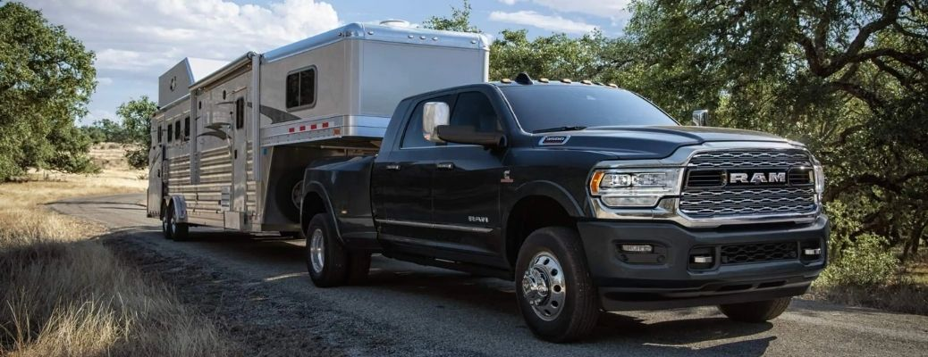 Black 2022 Ram 3500 towing a trailer. What are the engine specifications?