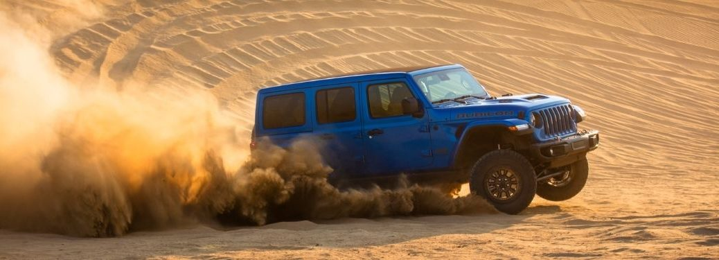 Blue 2021 Jeep Wrangler Driving in Sand Dunes