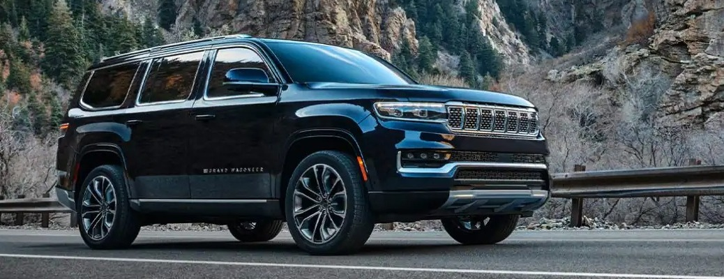 2022 Jeep Grand Wagoneer going past large rocks
