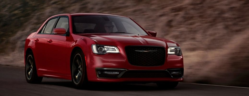 The 2021 Chrysler 300 Touring on road in a mountain background
