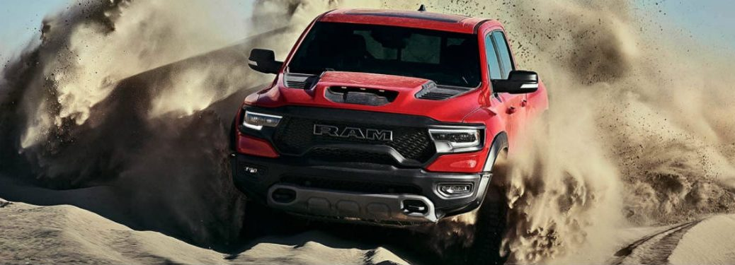 2021 Ram 1500 TRX in red driving through dust