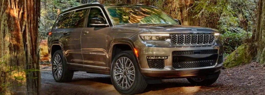 2021 Jeep Grand Cherokee L driving through the woods