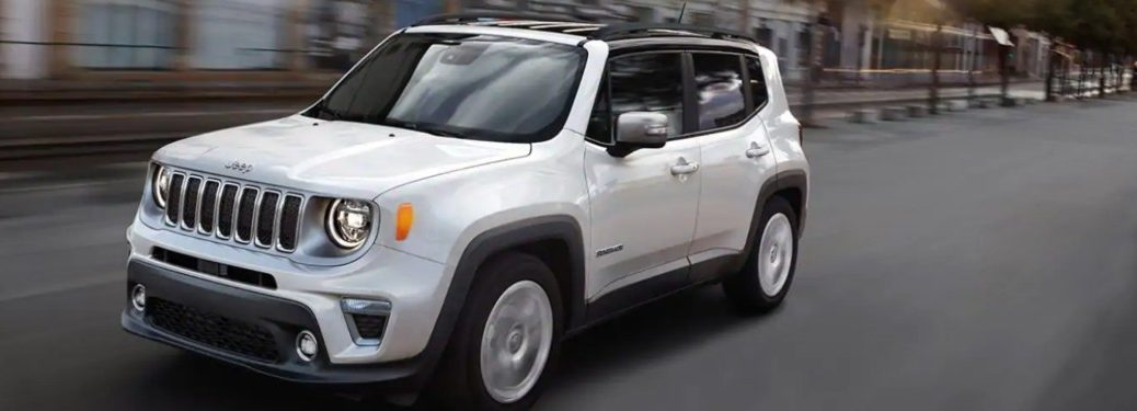 2021 Jeep Renegade driving down a city street