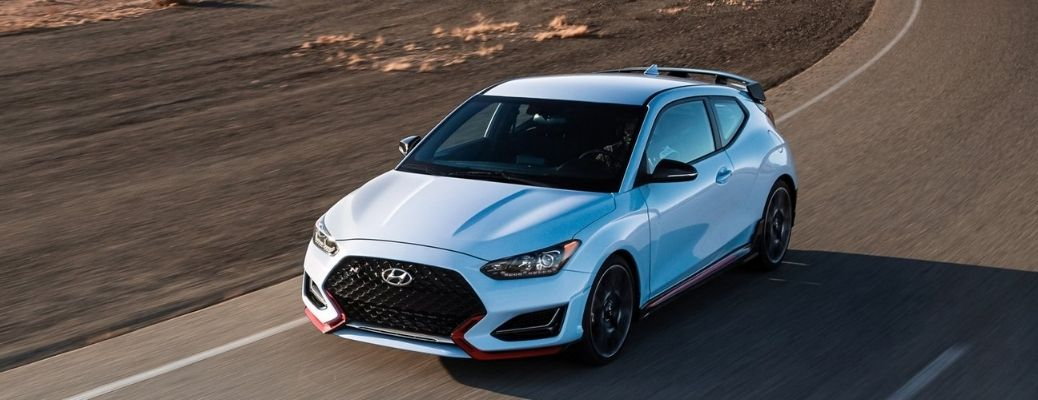 Arial view of a blue 2022 Hyundai Veloster N on road