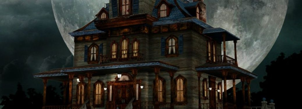 An old creepy mansion at night with dark sky and full moon in the background