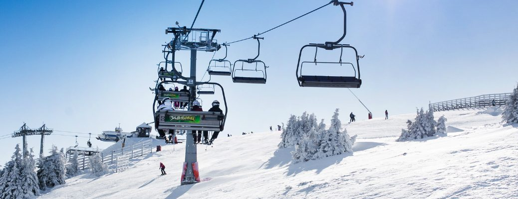 Skiers Going Up the Ski Lift