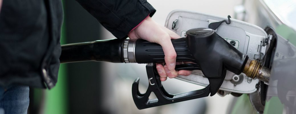 Woman Filling Up Her Car With Gas