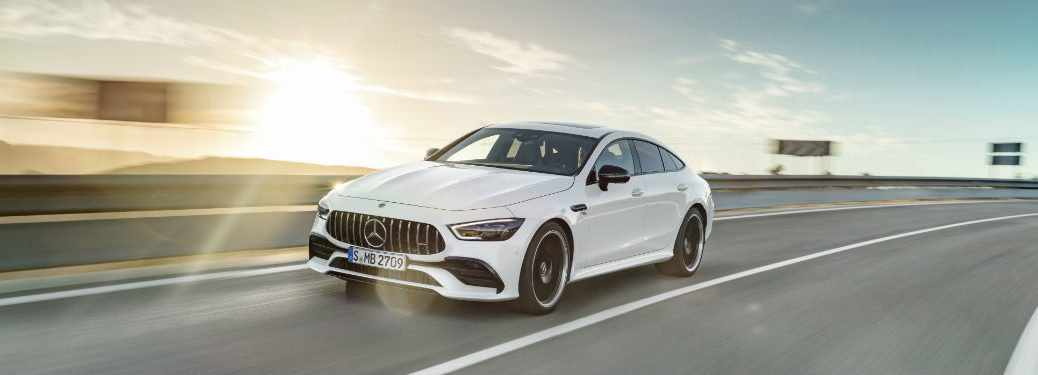 2019 Mercedes-AMG GT European model exterior front fascia side going fast with sun