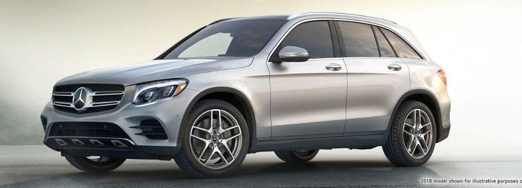 Driver side exterior view of a gray 2018 Mercedes-Benz GLC SUV