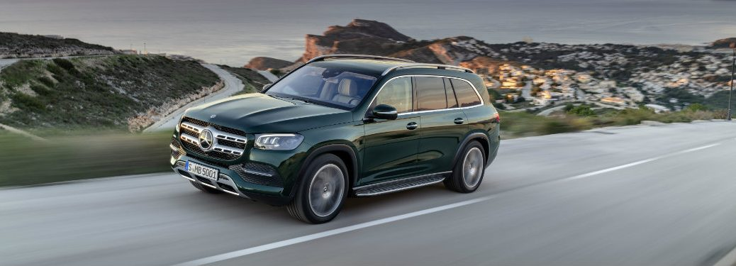 front, left side view of green mercedes benz gls driving on highway