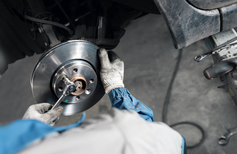 person working on brake rotor