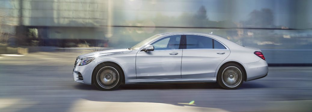 left side view of silver s-class car