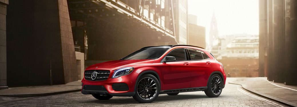 2020 MB GLA red exterior driver side front fascia parked on brick paved street