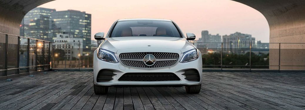 2020 MB C Class sedan white exterior front fascia city background